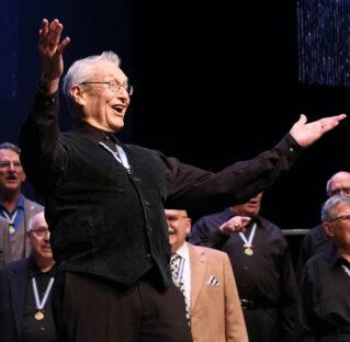 Joe Liles (1930-2021) directs the AISQC Chorus