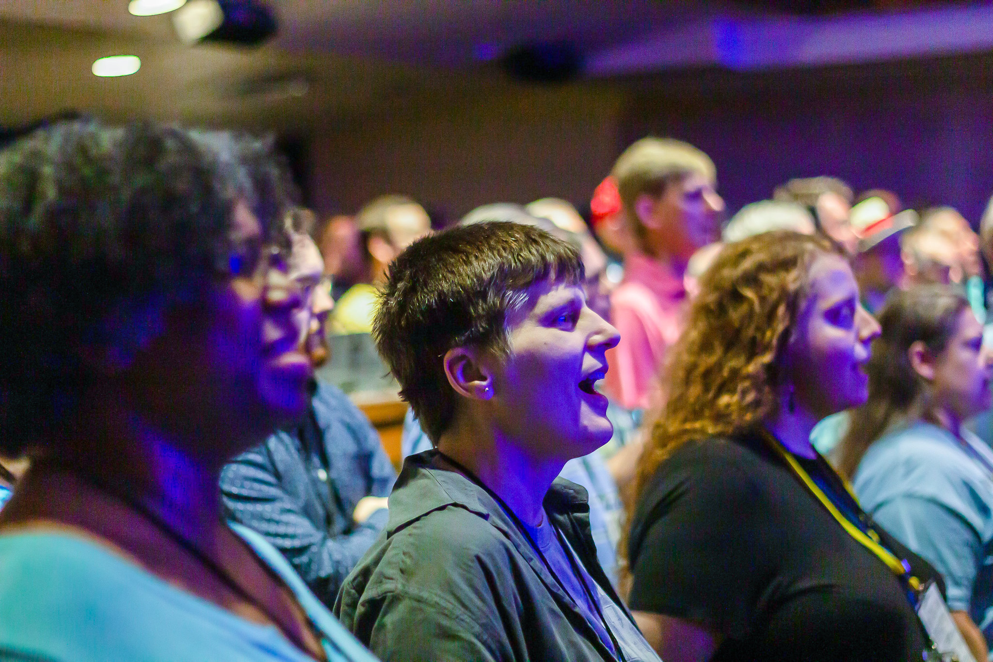 People sing during a session at Harmony University