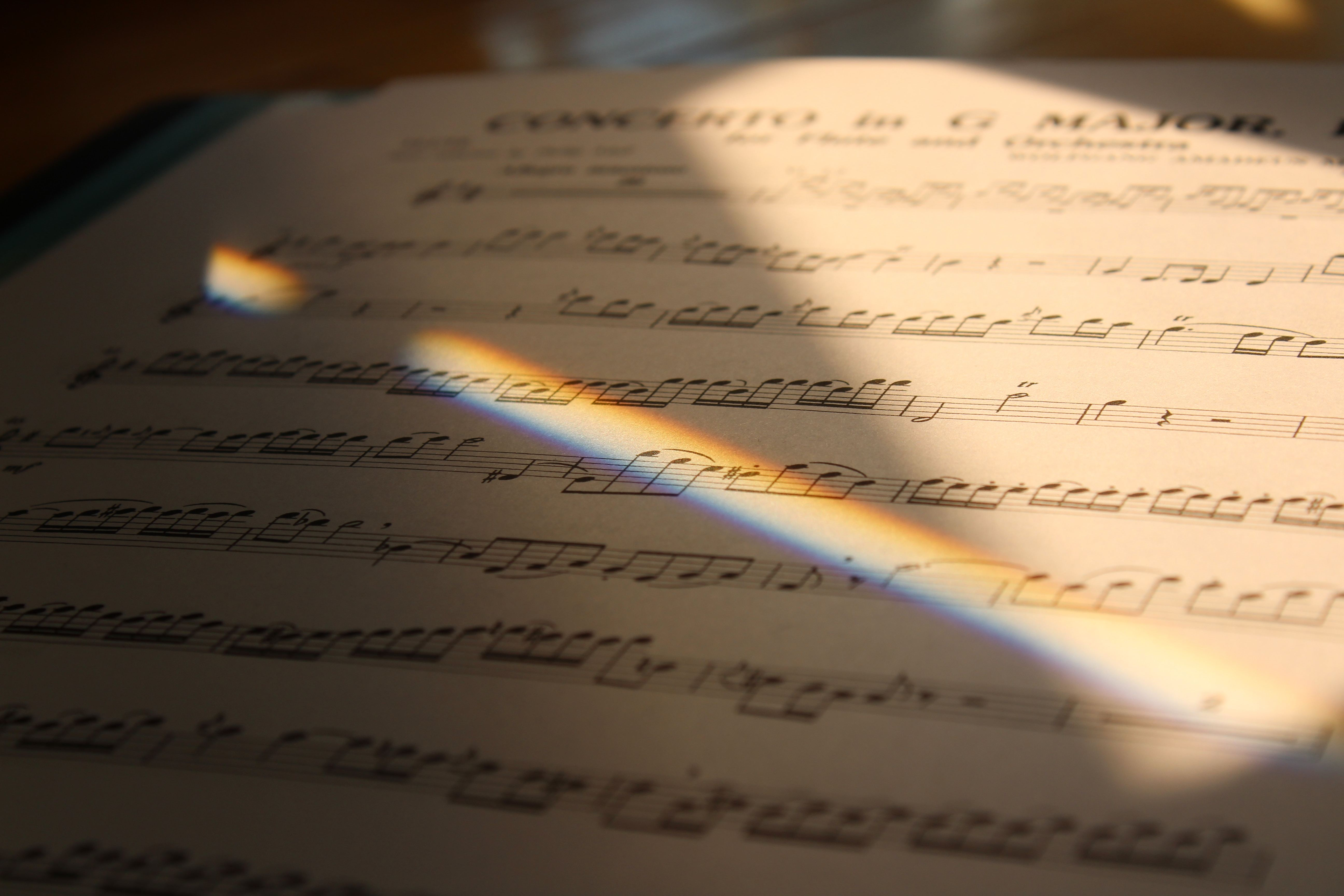 Sheet Music with rainbow light shining on it